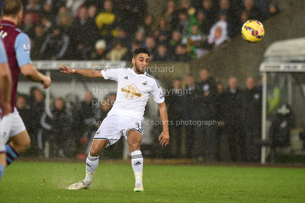 Neil Taylor of Swansea city in action. .Barclays Premier league match, Swansea city v Aston Villa at the Liberty stadium in Swansea, South Wales on Boxing Day, Friday 26th December 2014<br /> pic by Andrew Orchard, Andrew Orchard sports photography.