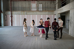 © Licensed to London News Pictures. 21/03/2017. London, UK. Performers stand in The Central School of Ballet's newly announced building in central London. The dancers wear costumes from their forthcoming nationwide Ballet Central tour 2017 against the backdrop of the unfinished interior of the new premises. Photo credit: Peter Macdiarmid/LNP