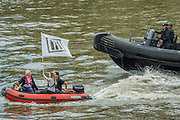 Ribs from the in campaign dart amongst the fleet, here chased by a Police patrol boat - Nigel Farage, the leader of Ukip, joins a flotilla of fishing trawlers up the Thames to Parliament to call for the UK's withdrawal from the EU, in a protest timed to coincide with prime minister's questions.