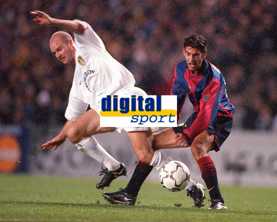 Danny Mills (Leeds) is tackled by Gerard (Barcelona). Leeds United v Barcelona. European Champions League, Group H, 24/10/00. Credit: Colorsport / Andrew Cowie.