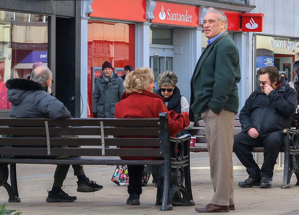 8th March, 2021. Cheltenham, England. Members of the public sitting down on a public bench during the first step of the Governments roadmap out of lockdown.