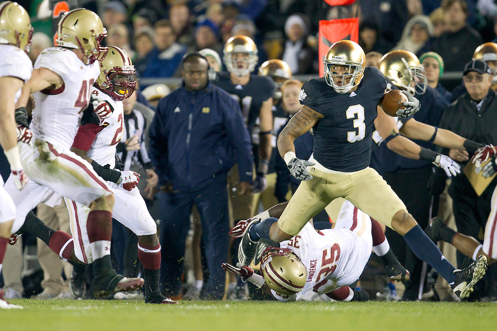 Notre Dame wide receiver Michael Floyd (#3) runs for yardage after catch during second quarter of NCAA football game between Notre Dame and Boston College.  The Notre Dame Fighting Irish defeated the Boston College Eagles 16-14 in game at Notre Dame Stadium in South Bend, Indiana.
