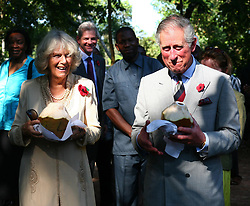 File photo dated 08/11/11 of the Prince of Wales and the Duchess of Cornwall tasting coconuts during a visit to the Kizimbani Spice Plantation in Zanzibar, Tanzania. Charles and Camilla are celebrating their 15th wedding anniversary on Friday, after they were reunited on Monday when the 72-year-old duchess came out of a 14-day self-isolation on the Balmoral estate in Aberdeenshire.