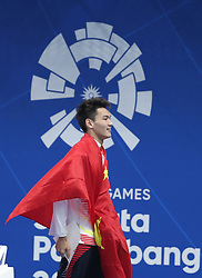 JAKARTA, Aug. 19, 2018  Xu Jiayu of China reacts after the awarding ceremony of Men's 100m Backstroke Final in the 18th Asian Games in Jakarta, Indonesia, Aug. 19, 2018. Xu won the gold medal. (Credit Image: © Fei Maohua/Xinhua via ZUMA Wire)