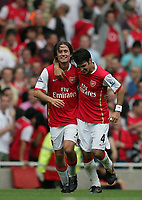 Photo: Lee Earle.<br /> Arsenal v Portsmouth. The FA Barclays Premiership. 02/09/2007.Arsenal's Tomas Rosicky (L) is congratulated by Cesc Fabregas after scoring their third.