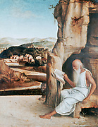 St Jerome in the Desert' attributed to Giovanni Bellini (1426-1516) Italian painter. Jerome (c340-420) a father of Western Christian Church and compiler of the Vulgate reading, his lion centre. Book Beard Cave Old Aged  Hermit