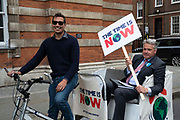 Tim Loughton Conservative MP, sits in a rickshaw at a climate change protest in Westminster, Central London, United Kingdom on 26th June 2019. Organisers of the Time is Now mass lobby demand politicians end the UKs contribution to climate change.