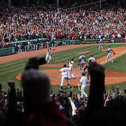 Dustin Pedroia, Boston Red Sox, celebrates as he crosses the plate for the winning run in Boston's 3-2 win over the Tampa Bay Rays after a hit from Mike Napoli in the ninth innings during the Boston Red Sox V Tampa Bay Rays, Major League Baseball game on Jackie Robinson Day, Fenway Park, Boston, Massachusetts, USA, 15th April, 2013. Photo Tim Clayton