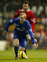 Photo: Aidan Ellis.<br /> Manchester United v Everton. The Barclays Premiership.<br /> 11/12/2005.<br /> Everton's Tony Hibbert holds off United's Ryan Giggs