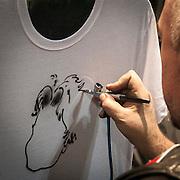 Motosalone Eicma edizione 2012: caricature realizzate con l'aerografo...International Motorcycle Exhibition 2012: caricatures realized with airbrush