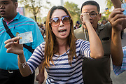 """01 FEBRUARY 2014 - BANGKOK, THAILAND: A Thai women screams at anti-government protestors blocking her access to the polls. She wanted to vote and was upset when protestors shut her polling place. Thais went to the polls in a """"snap election"""" Sunday called in December after Prime Minister Yingluck Shinawatra dissolved the parliament in the face of large anti-government protests in Bangkok. The anti-government opposition, led by the People's Democratic Reform Committee (PDRC), called for a boycott of the election and threatened to disrupt voting. Many polling places in Bangkok were closed by protestors who blocked access to the polls or distribution of ballots. The result of the election are likely to be contested in the Thai Constitutional Court and may be invalidated because there won't be quorum in the Thai parliament.    PHOTO BY JACK KURTZ"""
