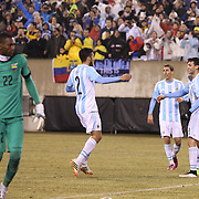 Javier Pastore, Argentina, scores his sides winning goal beating Ecuador keeper Alexander Domínguez,  in Argentina's  2-1 victory during the Argentina Vs Ecuador International friendly football match at MetLife Stadium, New Jersey. USA. 31st march 2015. Photo Tim Clayton