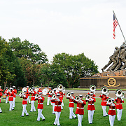 """United States Marine Drum and Bugle Corps, known as """"The Commandant's Own,"""" performing at the Marine Corps Sunset Parade at the Marine Corps Memorial (Iwo Jima Memorial) next to Arlington National Cemetery."""
