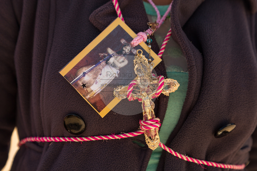 Indigenous pilgrims wearing religious icon and crucifix outside the Sanctuary of Atotonilco an important Catholic shrine in Atotonilco, Mexico.