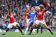 Nemanja Matic of Chelsea © is challenged by Marouane Fellaini of Manchester United ® and Eric Bailly of Manchester United. Premier league match, Chelsea v Manchester Utd at Stamford Bridge in London on Sunday 23rd October 2016.<br /> pic by John Patrick Fletcher, Andrew Orchard sports photography.