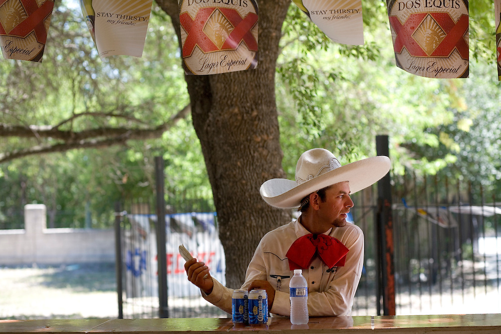 Julia Robinson photo.A charro buys cold drinks on a hot summer day at the Charro Ranch in San Antonio.  Food vendors provide cheap, tasty fare so you don't miss any of the action..