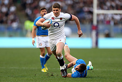 England's Owen Farrell races clear to score his side's third try during the NatWest 6 Nations match at the Stadio Olimpico, Rome.