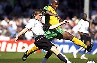 Photo: Daniel Hambury, Digitalsport<br /> Fulham v Norwich City.<br /> FA Barclays Premiership.<br /> 15/05/2005.<br /> Fulham's Brian McBride scores despite the close attention of Norwich's Damien Francis..