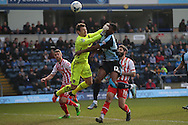 Rowan Liburd of Wycombe Wanderers gets a hand in the face from Goalkeeper Jamie Jones of Stevenage .Skybet football league two match, Wycombe Wanderers  v Stevenage Town at Adams Park  in High Wycombe, Buckinghamshire on Saturday 12th March 2016.<br /> pic by John Patrick Fletcher, Andrew Orchard sports photography.