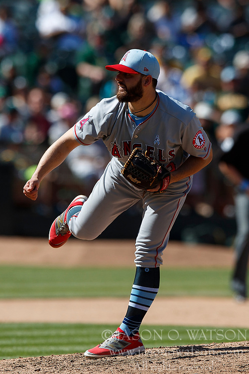 OAKLAND, CA - JUNE 17: Cam Bedrosian #32 of the Los Angeles Angels of Anaheim pitches against the Oakland Athletics during the tenth inning at the Oakland Coliseum on June 17, 2018 in Oakland, California. The Oakland Athletics defeated the Los Angeles Angels of Anaheim 6-5 in 11 innings. (Photo by Jason O. Watson/Getty Images) *** Local Caption *** Cam Bedrosian