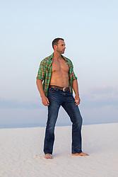 hot muscular man outdoors with an open shirt