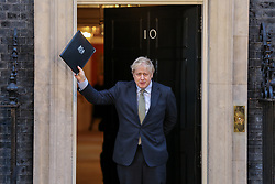 © Licensed to London News Pictures. 13/12/2019. London, UK. British Prime Minister and leader of the Conservative Party, BORIS JOHNSON, waves to the media after making a statement in Downing Street. Photo credit: Dinendra Haria/LNP