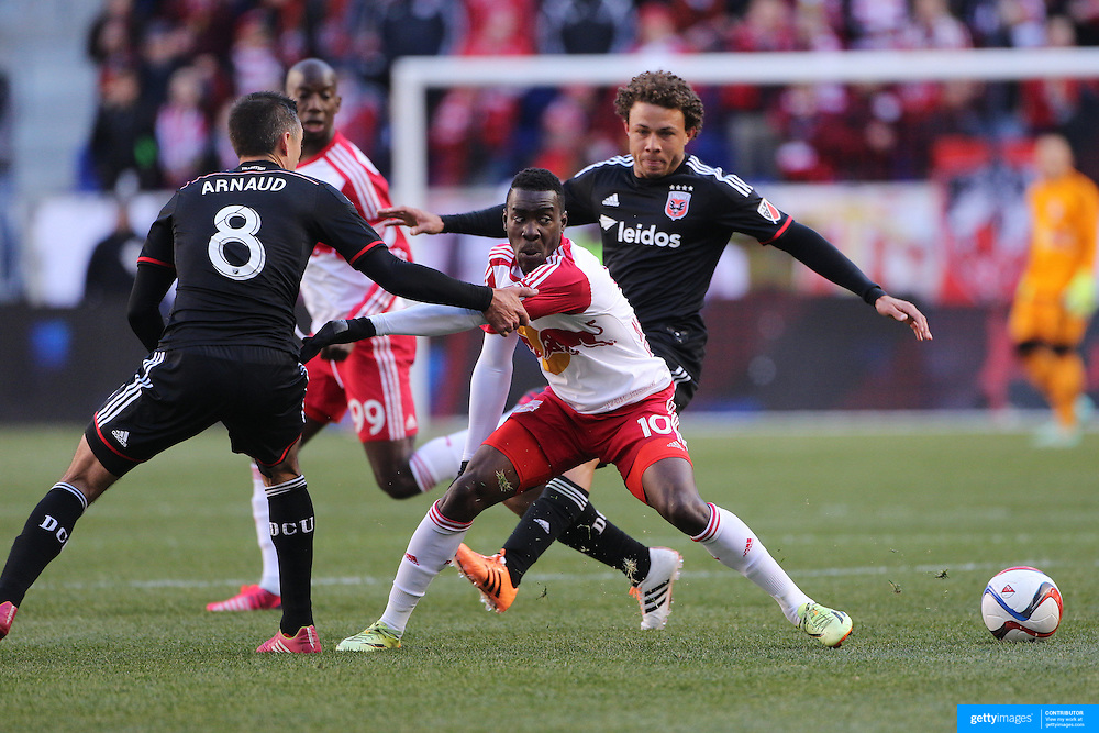 Lloyd Sam, New York Red Bulls, is challenged by Davy Arnaud, D.C. United, during the New York Red Bulls Vs D.C. United, Major League Soccer regular season opening match at Red Bull Arena, Harrison, New Jersey. USA. 22nd March 2015. Photo Tim Clayton