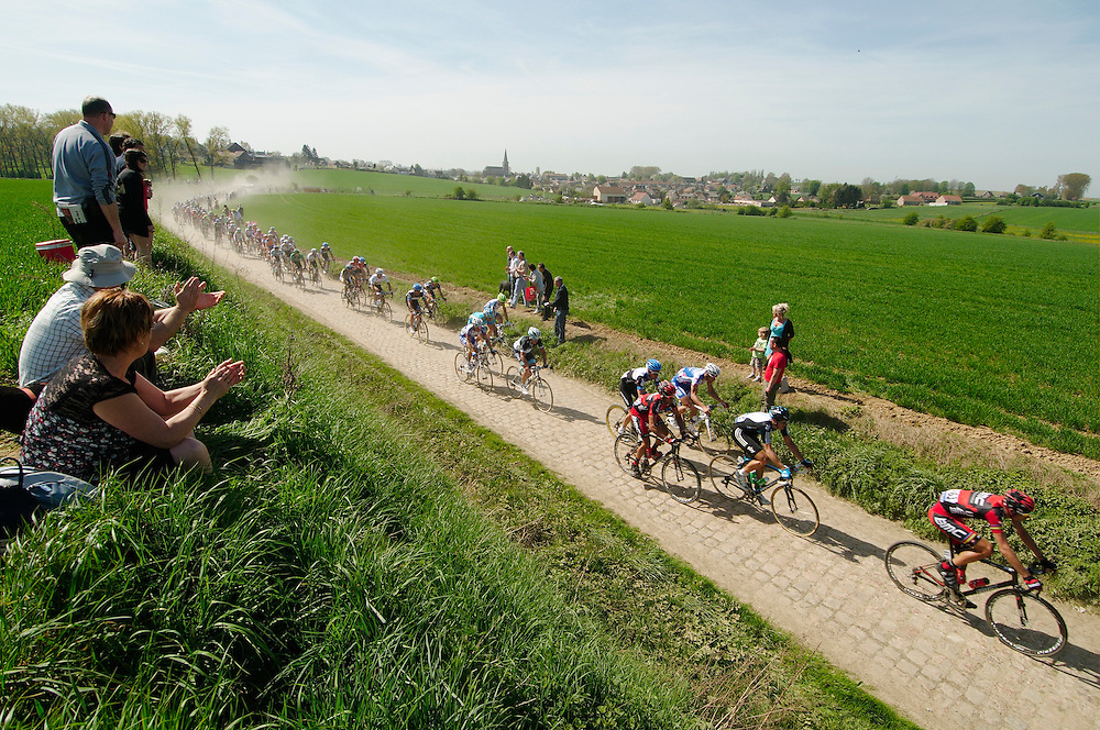 All together and hitting the first pace section. Paris Roubaix classic, 2011