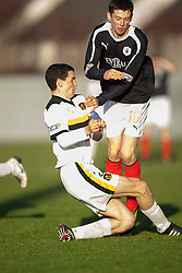 Dumbarton's PaulMcGinn and Falkirk's Conor McGrandles..Dumbarton 0 v 2 Falkirk, 23/2/2013..©Michael Schofield.
