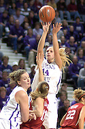 Kansas State guard Claire Coggins (14) scores over Oklahoma's Laura Andrews (11) and teammate Jessica McFarland (lower left), during the second half at Bramlage Coliseum in Manhattan, Kansas, February 21, 2006.  The 9th ranked Sooners defeated K-State 78-64.
