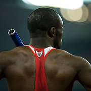 LaShawn Merritt of the United States waited to begin the men's 4 X 100m relay with the baton tucked under the shoulder strap of his track suit on August 23, 2008 during the 2008 Summer Olympic Games in Beijing, China. (photo by David Eulitt / MCT)
