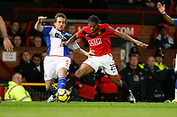 Photo: Steve Bond/Richard Lane Photography. Manchester United v Blackburn Rovers. Barclays Premiership 2009/10. 31/10/2009. Antonio Valencia (R) tangles with Gael Givet