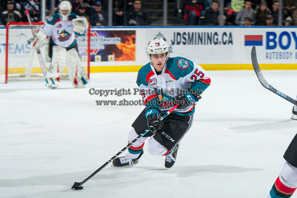 KELOWNA, CANADA - JANUARY 25:   Kyle Crosbie #25 of the Kelowna Rockets skates with the puck against the Victoria Royalson January 25, 2019 at Prospera Place in Kelowna, British Columbia, Canada.  (Photo by Marissa Baecker/Shoot the Breeze)