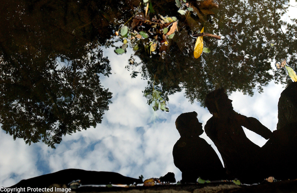 Actors Elijah Wood, right, and Sean Astin who both star in the Lord of the Rings trilogy are seen reflected in water in Central Park in Manhattan, NY. 10/16/2003 Photo by Jennifer S. Altman