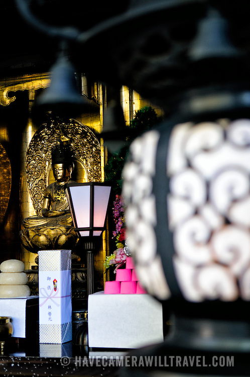 A small shrine at the rear of the Great Main Hall shot with a shallow depth of field. The Narita-san temple, also known as Shinsho-Ji (New Victory Temple), is Shingon Buddhist temple complex, was first established 940 in the Japanese city of Narita, east of Tokyo.
