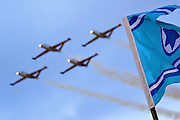Israeli Air force (IAF) Fouga Magister CM-170 in aerobatics display IAF flag in the foreground