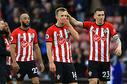 Southampton's James Ward-Prowse (centre) and Pierre-Emile Hojbjerg celebrate after the final whistle