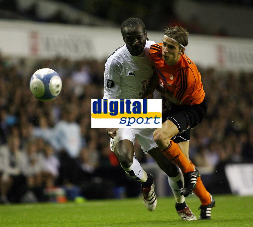 Photo: Chris Ratcliffe.<br /> Tottenham Hotspur v Slavia Prague. UEFA Cup. 28/09/2006.<br /> Pascal Chimbonda of Spurs clashes with Dusan Svento of Slavia Prague.