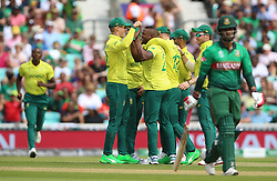 South Africa's Andile Phehlukwayo (centre) celebrates after taking the wicket of Bangladesh's Tamim Iqbal during the ICC Cricket World Cup group stage match at The Oval, London.