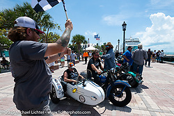 Jake and Ginger Martin riding their 1941 Harley-Davidson FL Knucklehead with a sidecar as they ride over the finish line of the Cross Country Chase motorcycle endurance run from Sault Sainte Marie, MI to Key West, FL. (for vintage bikes from 1930-1948). The Grand Finish in Key West's Mallory Square after the 110 mile Stage-10 ride from Miami to Key West, FL and after covering 2,368 miles of the Cross Country Chase. Sunday, September 15, 2019. Photography ©2019 Michael Lichter.