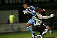 Photo: Rich Eaton.<br /> <br /> Hereford United v Wycombe Wanderers. Coca Cola League 2. 12/09/2006. Jermaine Easter left of Wycombe beats Hereford goalkeeper Scott Tynan to the ball to score the opening goal of the game