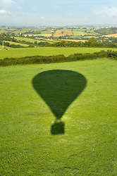 © Licensed to London News Pictures. 06/08/2012. Bristol, UK. Bailey balloon's shadow on a field as it comes into land during the press launch for the Jones Lang LaSalle Bristol International Balloon Fiesta which runs from 09-12 August at Ashton Court in Bristol.  This year's fiesta is sponsored by Jones Lang LaSalle. 06 August 2012..Photo credit : Simon Chapman/LNP