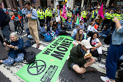 © Licensed to London News Pictures. 15/07/2019. London, UK. Extinction Rebellion protesters block the road outside The Royal Courts of Justice. They are campaigning against climate change.  Photo credit: George Cracknell Wright/LNP