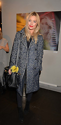 Laura Whitmore at an exhibition of photographs by Erica Bergsmeds held at The Den, 100 Wardour Street, London England. 19 January 2017.