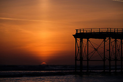 © Licensed to London News Pictures. <br /> 06/04/2017<br /> Saltburn-by-the-Sea, UK. <br />  <br /> A spectacular sun column is seen as the sun rises at Saltburn-by-the-Sea in North Yorkshire. <br /> <br /> A column or light pillar is an atmospheric optical phenomenon in the form of a vertical band of light which appears to extend above a light source. The effect is created by the reflection of light from numerous tiny ice crystals suspended in the atmosphere or clouds.<br /> <br /> Photo credit: Ian Forsyth/LNP