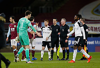 Football - 2020 / 2021 Premier League - Burnley vs. Fulham<br /> <br /> Referee Jonathan Moss and his assistants with Harrison Reed of Fulham at the final whistle, at Turf Moor.<br /> <br /> <br /> COLORSPORT/ALAN MARTIN