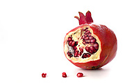 pomegranate with seeds seeds, Symbols of Roah Hashanah the Jewish New Year on white background