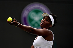 Venus Williams in action against Alexandra Dulgheru on day three of the Wimbledon Championships at the All England Lawn Tennis and Croquet Club, Wimbledon.