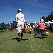 'A Day at the Polo'<br /> A family arrive with their picnic basket  during the International Polo Test match between Australia and England at the Windsor Polo Club, Richmond, Sydney, Australia on March 29, 2009. Australia won the match 8-7.  Photo Tim Clayton