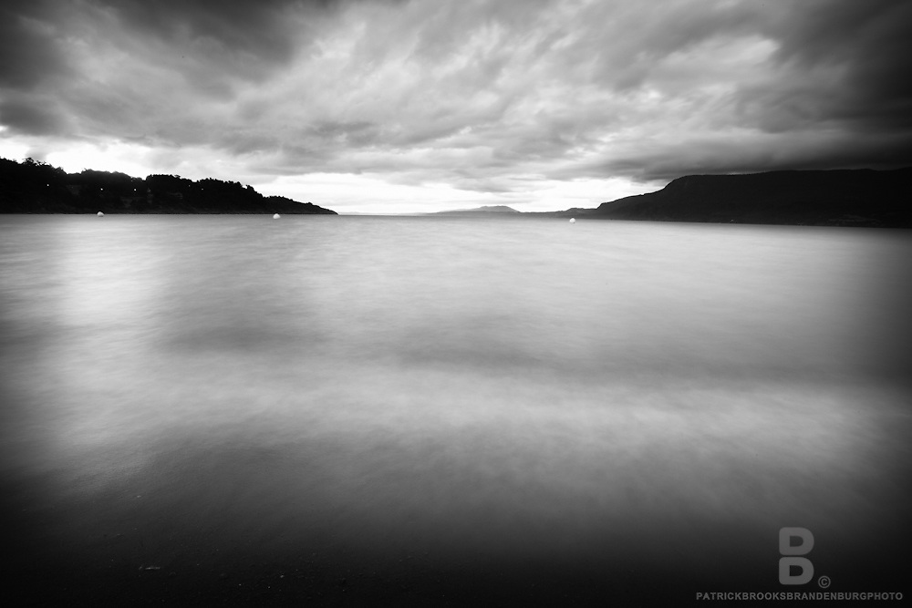 A long exposure of shorline and lake in Pucon, Chile.